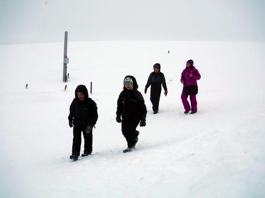 Children walking to school in Wales, Alaska, provide