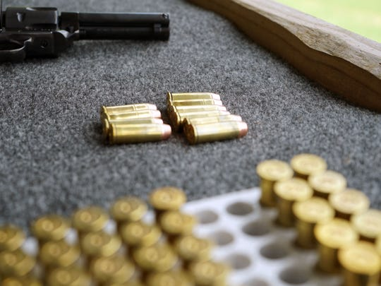 Bullets sit on a shelf awaiting loading into a vintage-style