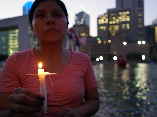 Judy Mendoza holds a candle during a vigil June 11, 2016, for the slain Dallas police officers.