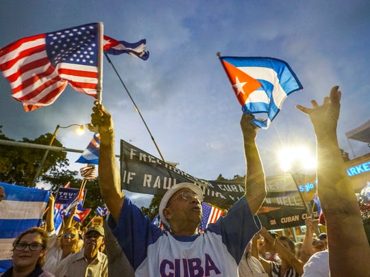 Jose Frandin of Miami left Cuba 17 years ago celebrates after the Cuban Anthem. The Bay of Pigs Veterans Association held a rally in Little Havana for Cuban freedom. These older Cuban exiles are dwindling, while the younger generation of Cubans are more lenient toward the Castro regime.
