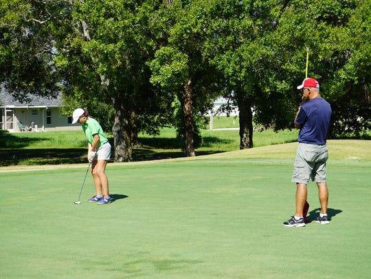 A family bonding over golf for PGA's Family Golf Month.