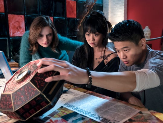Joey King (left, with Alice Lee and Ki Hong Lee) stumbles