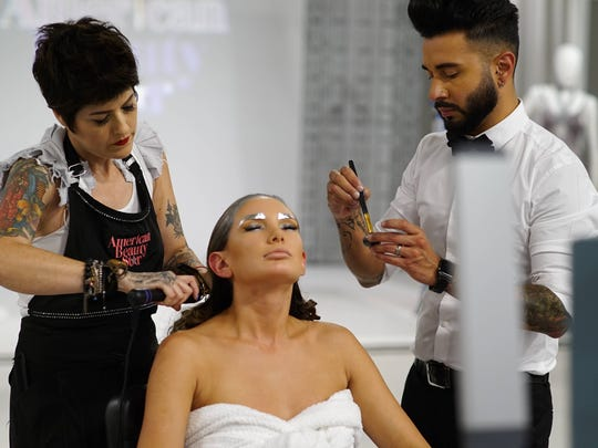 Stylists ready their model for a challenge on 'American