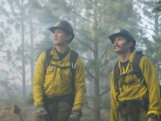 Brendan McDonough (Miles Teller), Chris MacKenzie (Taylor Kitsch), plan to do the backburn at the Chiricahua Mountain fireline in 'Only the Brave.'