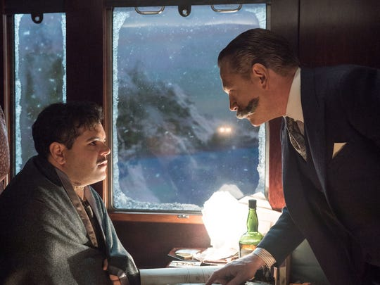 Personal assistant Hector MacQueen (Josh Gad, left) is questioned by super-sleuth Hercule Poirot (Kenneth Branagh) in the Agatha Christie adaptation 'Murder on the Orient Express.'