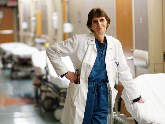 Dr. Sandy Gibney is an ER doctor at St. Francis Hospital