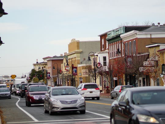Traffic flows along historic Main Street in downtown