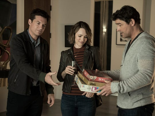 Jason Bateman and Rachel McAdams get competitive with Kyle Chandler in 'Game Night.'
