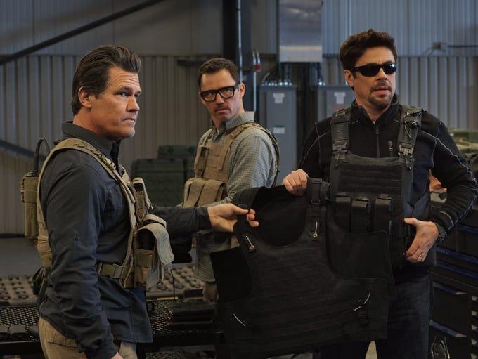 Josh Brolin, left, Jeffrey Donovan and Benicio del