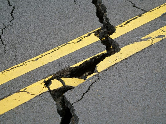 A crack stretches across Pohoiki Road near the Leilani