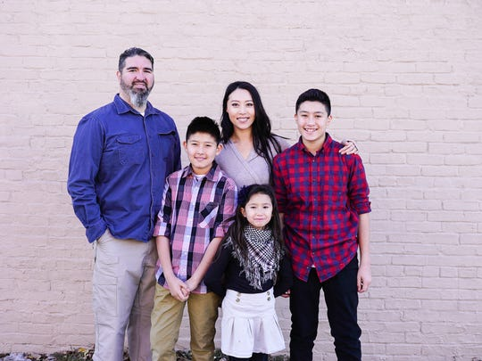 Rev. Saehee Duran, center, with her husband, Rev. Damon Duran, and their children. Saehee Duran grew up in South Korea and is now a pastor at Life360 Intercultural Campus in Springfield.