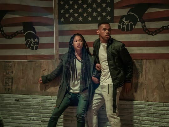 """Nya (Lex Scott Davis) and Isaiah (Joivan Wade) are on the run  hide in """"The First Purge."""""""