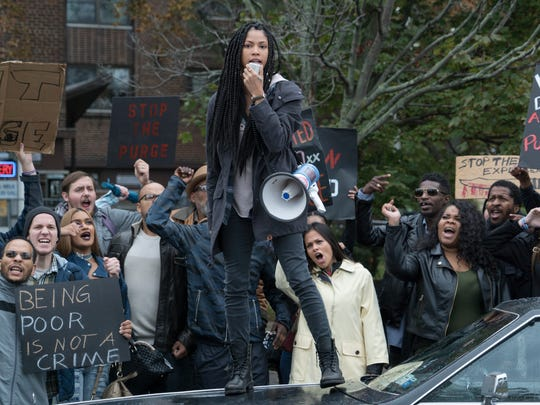 """This image released by Universal Pictures shows Lex Scott Davis in a scene from """"The First Purge."""" (Annette Brown/Universal Pictures via AP)"""