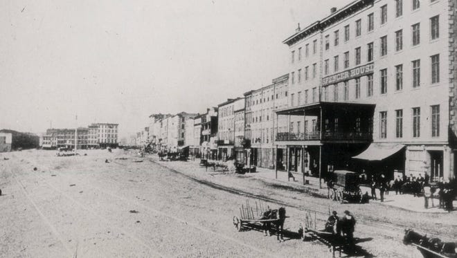 The Spencer House at Broadway and Front Streets was a landmark hotel at the Public Landing in 1893.