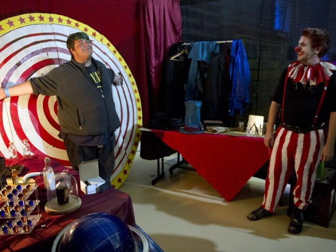 Logan Flanagan (left) of Palm Bay tests out the wheel of death Saturday as Jason Wallerstein (right) of Port St. Lucie leads a tour through a creep walk haunted house called, 'Balthazar's Band of Beauties Live!' Saturday during the Treasure Coast Freak Show at the Havert L. Fenn Center in Fort Pierce. 'I've been looking forward to this for months,' said Wallerstein, who makes a living as a web developer. 'This is a creative outlet for me.' Wallerstein made the wheel of death as well as other props. In addition to the freak show, which is a presentation of classic sideshows found in a traveling circus in the early 1900s, the event consists of meet and greets and photos ops with actors from horror movies and shows, vendors selling horror items and screenings of classic horror films. The Treasure Coast Freak Show continues Sunday from 10 a.m. to 5 p.m.