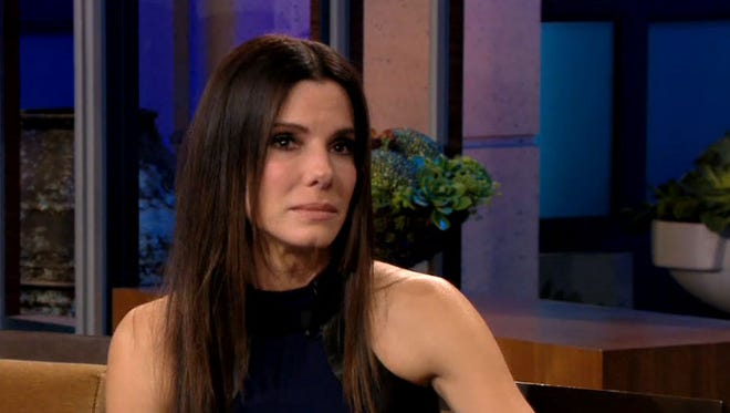 Sandra Bullock stops by Jay Leno's 'Tonight Show' for a teary farewell on Wednesday.
