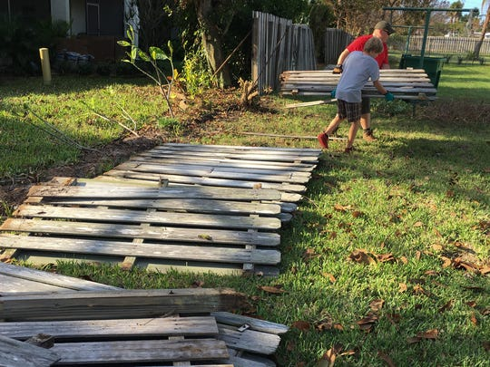 After Hurricane Irma left his fence damaged, Indian Harbour Beach resident Howard Crisp headed to City Hall seeking answers about property lines. The result: Boy Scouts from four troops showed up at  his house Wednesday evening to take down the fence.