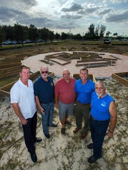 Members of the three Rotary clubs of Cape Coral have combined forces to build a community garden next to City Hall. From left: Phil Deems Jr., Donald Vasbinder, Philip Arnold, Erik Elsea and Joe Zagame.
