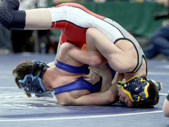 Senior John Worthing, seen here wrestling Central Valley Academy's Marek Bush in a state quarterfinal two years ago, will lead top-seeded Tioga in the NYSPHSAA Division II Dual Meet Tournamaent on Saturday at Onondaga Community College's SRC Arena.