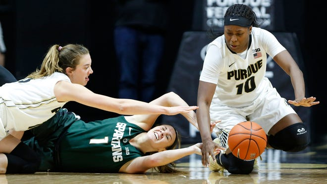 Bridget Perry and Andreona Keys combine to try and steal the ball from Michigan State's Tori Jankoska Wednesday, January 4, 2017, at Mackey Arena. Purdue defeated Michigan State 66-54.