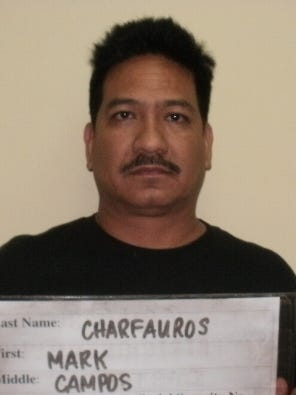 PDN file photo Then-Police Capt. Mark Charfauros, in this January 2012 photo, had his mugshot taken in connection with his arrest for solicitation of assault and official misconduct. All charges were dismissed in May 2012. Police Capt. Mark Charfauros, in this January 2012 photo, had his mugshot taken in connection with his arrest for solicitation of assault and official misconduct. All charges were dismissed in May 2012.