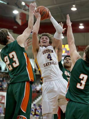Guerin Catholic Golden Eagles Matt Holba is fouled by Vincennes Lincoln Alices Ethan Claycomb,left, in the first half of their IHSAA Boys 3A Semi-State basketball game Saturday, March21, 2015, afternoon at Southport High School.