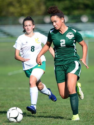 Fairfield's Annabel Anderson (2) heads upfield with York Catholic's Caroline Bandelin (8) in pursuit during the first half of a 15-0 win over York Catholic on Thursday in York.