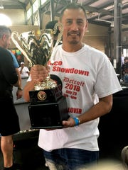 Javier Fortoso of Torti Taco in Battle Creek holds the first-place trophy at the Taco Showdown at Eastern Market in Detroit .