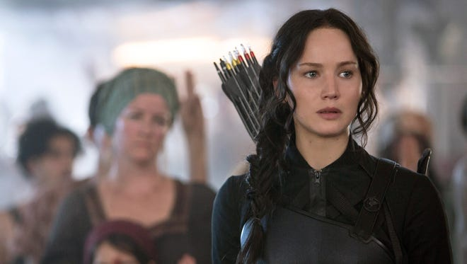 "Jennifer Lawrence portrays Katniss Everdeen in ""The Hunger Games: Mockingjay — Part 1."""