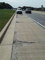 Cracked concrete, which exists on Centre Road near