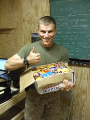 A service member with candy from the Halloween Candy