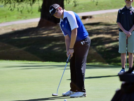 Fort Defiance's Christian Michael putts on the 9th