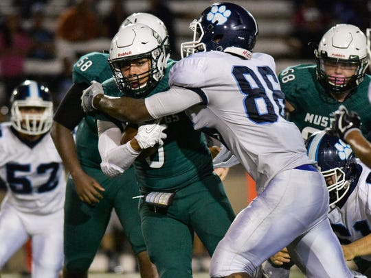 King's Jameel West is tackled for no gain against Carroll