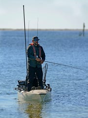 Brandon Barton does some fishing from his kayak in Big Lagoon. Gulf Breeze Optimist Club Family Fishing Rodeo has added kayak fishing to its 43rd annual event.