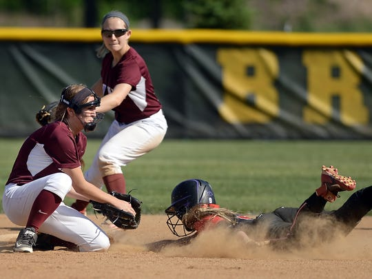 Aquinas' Emily Monachino, left, tags Geneva's Madison Cooley out at second base.