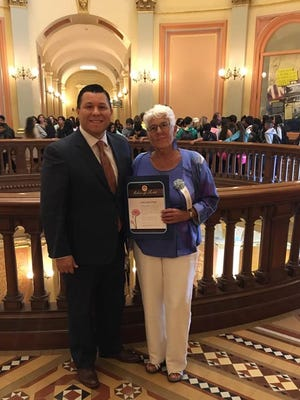 Holocaust survivor Yoka Brouwer, of Desert Hot Springs, stands with Assemblyman Eduardo Garcia at a Holocaust remembrance ceremony held Monday, April 24, 2017, at the state capitol in Sacramento.