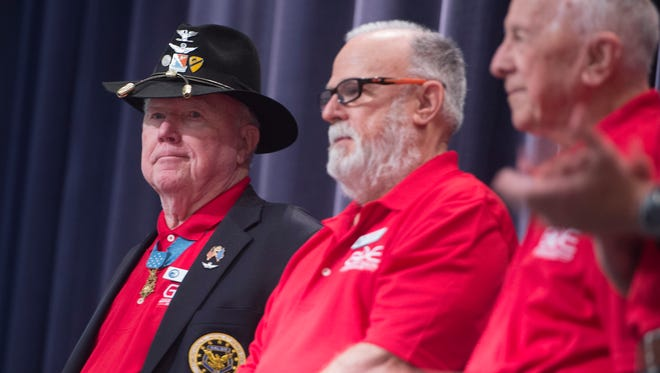 Bruce Crandall, left, Medal of Honor recipient and Vietnam Veteran, is introduced during the Gathering of the Eagles at Maxwell Air Force Base on Wednesday, June 3, 2015.
