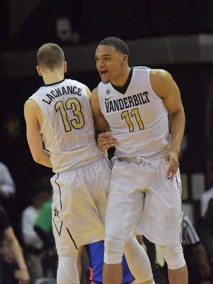 Vanderbilt Commodores guard Riley LaChance (13) and forward Jeff Roberson (11) celebrate during the second half at Memorial Gymnasium. Vanderbilt won 73-71.