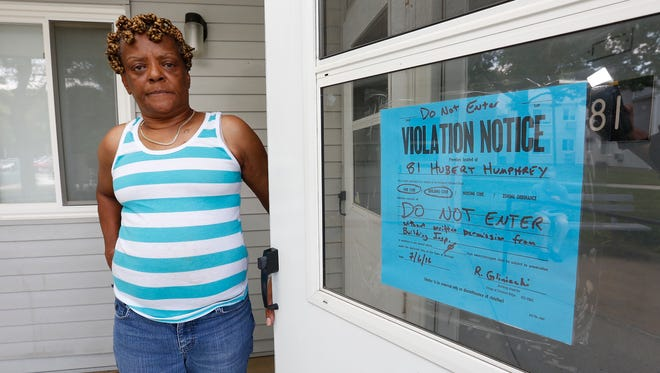 Gwenette Lindsey, 69, stands outside her locked apartment at Chestnut Ridge Gardens on Friday.