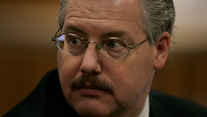 Calumet County District Attorney Ken Kratz sits in the courtroom before the start of the Steven Avery trial at the Calumet County Courthouse on Feb. 22, 2007, in Chilton.