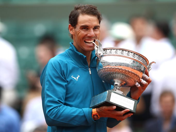 Rafael Nadal holds the Musketeers' Cup as he celebrates