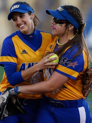 Angelo State's Brooke Mangold (left) drove in the Belles' only run and pitcher Brandy Marlett threw a one-hitter as ASU edged West Chester 1-0 in their opening game of the NCAA D-II College World Series in Salem, Virginia on Thursday.