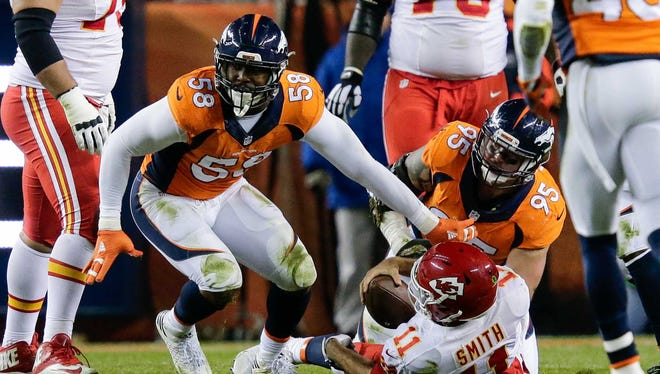 Denver Broncos outside linebacker Von Miller (58) celebrates after sacking Kansas City Chiefs quarterback Alex Smith (11) in the second quarter at Sports Authority Field at Mile High