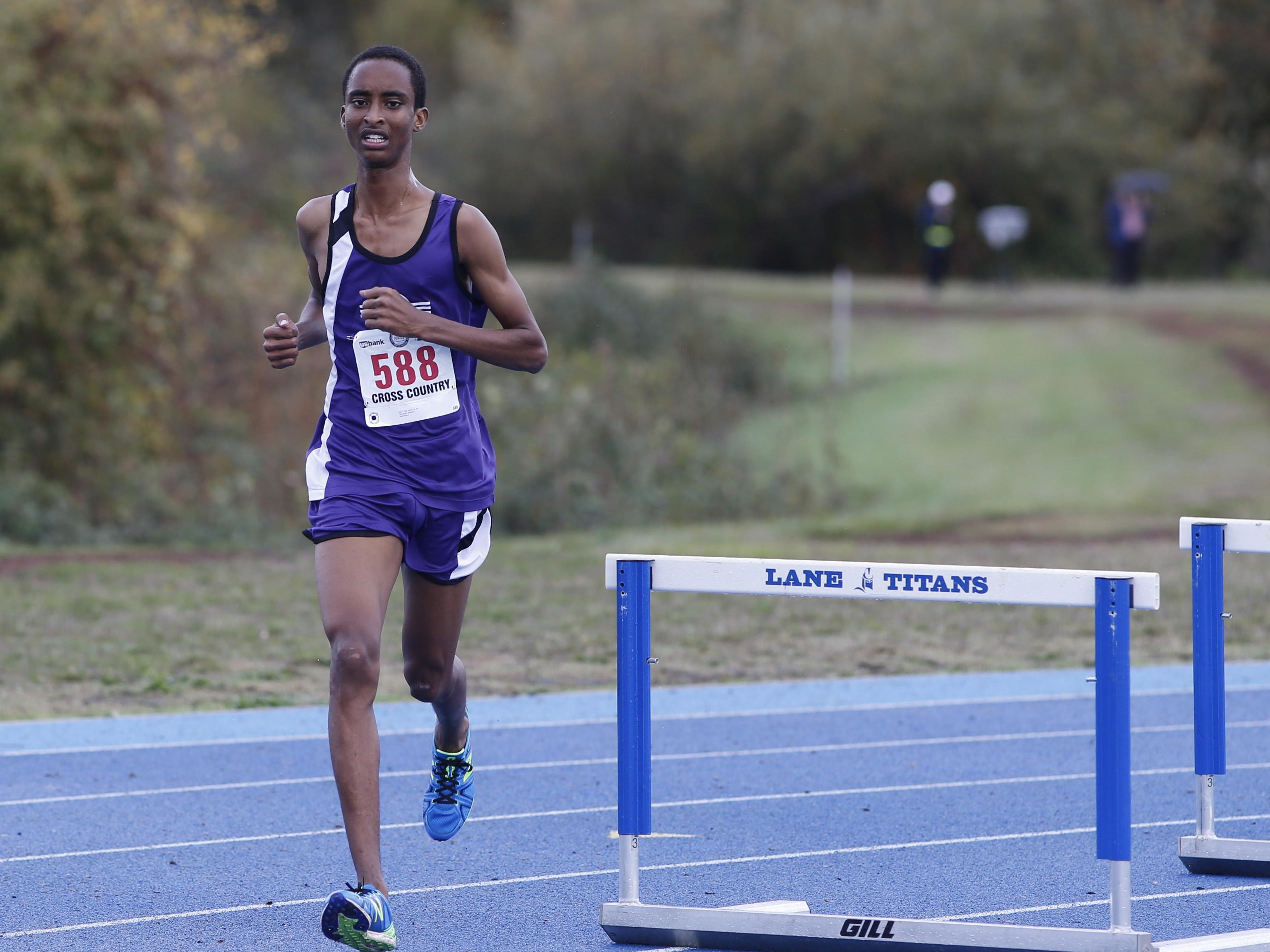 Jefferson's Hassan Ibrahim runs to a second place finish in the 3A/2/1A state cross country championships at Lane Community College on Saturday, Oct. 31, 2015. (Timothy J. Gonzalez/For the Statesman Journal)