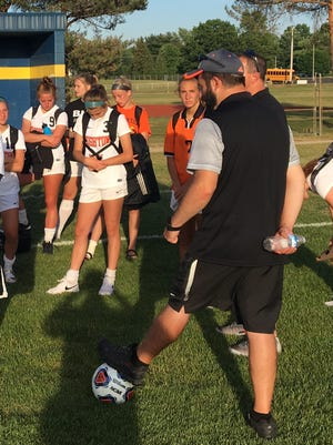 Brighton coach Chris Stevanovic addresses his soccer team after a 3-1 loss to Grand Rapids Forest Hills Central in the regional championship game at Portage Central on June 9, 2017.