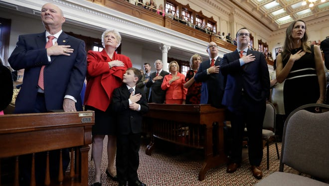 Ben Scogin (center) joins his grandfather, state Rep. John Raney (left), R-College Station, in the pledge during the opening of the 85th Texas Legislative session at the Texas State Capitol on Tuesday, Jan. 10, 2017, in Austin.