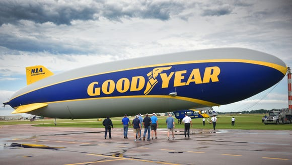 Passengers board The Goodyear Blimp at the Sioux Falls