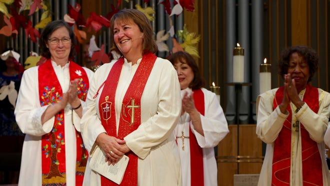 Bishop Karen Oliveto, a pastor in San Francisco, became the first married gay United Methodist bishop.