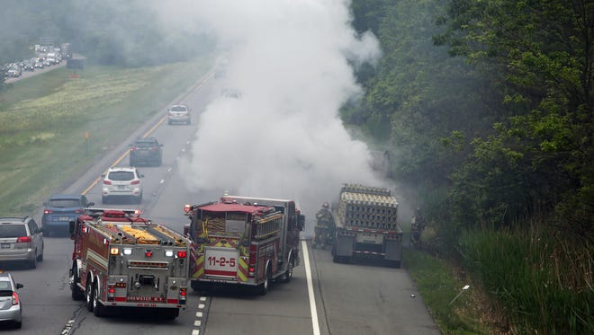 A truck fire on eastbound Interstate 84 just east of Interstate 684 in Southeast has one lane blocked as Brewster firefighters work to control the fire June 8, 2015. The truck was carrying concrete dividers. Traffic eastbound on I-84 was backed up for two miles approaching the scene. There were no injuries.
