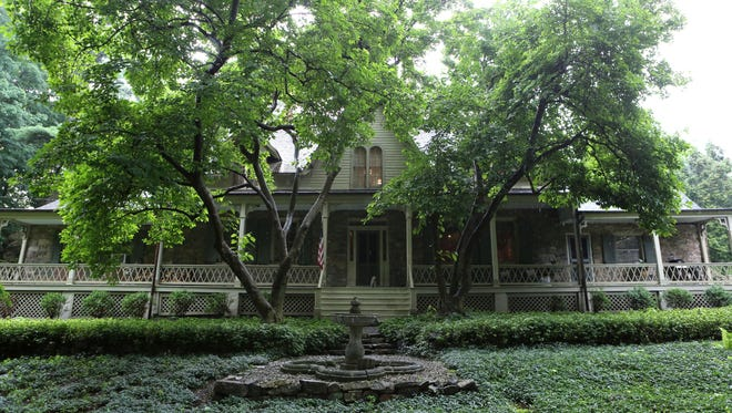 """A sprawling front porch adds to the historic charm of """"The Big House,"""" which was likely built in 1737."""